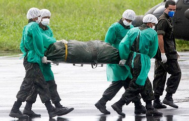Members of the Brazilian Air Force carry the body of a victim of Air France flight 447 that went missing en route from Rio to Paris, at a base in Fernando de Noronha island on June 9, 2009. Air France flight 447 crashed en route to Paris from Rio de Janeiro, killing all 228 people on board in an incident experts are still trying to understand. (REUTERS)