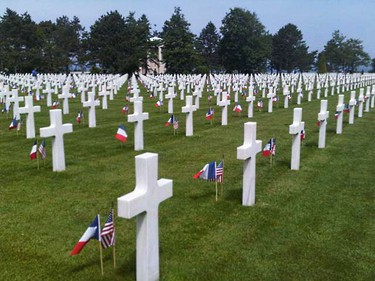 White crosses mark the graves of more than 9,000 American soldiers killed in the Second World War. Prime Minister Stephen Harper joined other world leaders there for commemorative ceremony to mark the 65th anniversary of D-Day. (KATHLEEN HARRIS/SUN MEDIA)