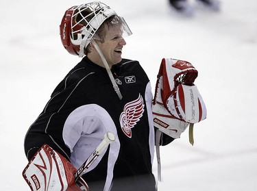 Chris Osgood laughs during Red Wings practice at Joe Louis Arena ahead of the Stanley Cup Finals in Detroit, Michigan on May 29, 2009. (DAVE ABEL, Sun Media)