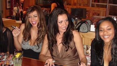 Edmonton pageant contestants (from left) Mandy and Tania, and Dartmouth waitress Twila. Twenty young women from across the country compete in the 10th Annual Miss Hooters of Canada pageant on Wednesday, May 27, 2009. The winner is guaranteed a spot in this year's international pageant in Hollywood, Fla. (Adam Clayton/SUN MEDIA)