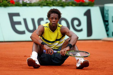 Gael Monfils of France sits on the court during his match against Victor Crivoi of Romania at the French Open tennis tournament at the Roland Garros stadium in Paris on May 28, 2009. (REUTERS)