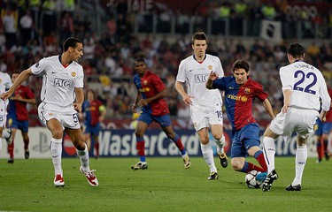 Barcelona's Lionel Messi (2nd R) dribbles against Manchester United's John O'Shea (22), Rio Ferdinand (L) and Michael Carrick during their Champions League final soccer match at the Olympic Stadium in Rome on May 27, 2009. (REUTERS)