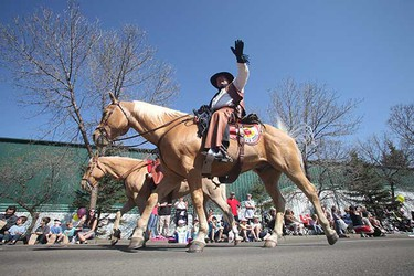 May 23: A man waves to the crowd during the Kinsmen Rainmaker Parade in St. Albert. (Ken Armstrong/Sun Media)