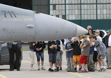 A group of school kids look on at the recently landed CF-18 fighter from Bagotville, Quebec at the Wings and Wheels Heritage Festival on May 22, 2009. (MICHAEL PEAKE, Sun Media)