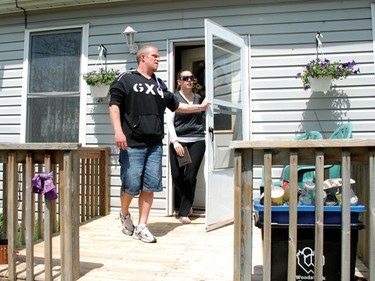 Victoria Stafford's parents Tara McDonald and Rodney Stafford emerge from McDonald's Frances Street house in Woodstock Tuesday afternoon. The pair vowed to only talk about their missing daughter in future press conferences. (Sun Media/Elliot Ferguson)