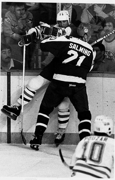 Borje Balming of the Toronto Maple Leafes ties up Wayne Gretzky along the boards during an NHL game. (Sun file photo)