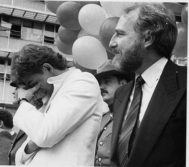 More than 100,000 Oiler fans thronged through downtown streets to honour the Stanley Cup champions. Wayne Gretzky takes a moment to catch his breath as he stood on the podium with owner Peter Pocklington.