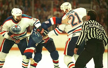Game 3 finals 1984-- Edmonton Oilers Don Jackson and Randy Gregg gang up in a fight with the New York Islanders Pat Flatley during game #3 at the Edmonton Coliseum.  (Sun file photo)
