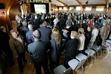 May. 18: The Ukrainian National Hall is packed with funeral attendees watching a video feed for Edward Stawnichy from the Sts. Peter and Paul Ukrainian Catholic Church during his funeral in Mundare.