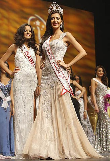 Miss Universe Canada 2008 Samantaha Tajik glides across the stage at the  John Bassett Theatre at the Metro Toronto Convention Centre for the final time before relinquishing her crown to Mariana Valente. (JACK BOLAND, Sun Media)