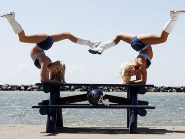 The Argo Cheerleaders during their photo shoot at the Argonaut rowing club. Shannon poses for her pictures. Blaire (L) and Margherita (R) stretch a little before their shoots.  (Craig Robertson/SUN MEDIA)
