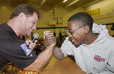 Grade 7 student Scott Williams arm wrestles WWE superstar and Edmonton's own Chris Benoit in the Gymnasium at St. Edmund Elementary/Junior High School, April 2004. Benoit visited the school he attended as a kid to meet the students, pose for photos and sign autographs, and talk to the kids. (Sun Media File Photo)