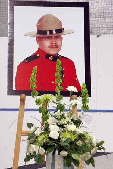 Pictures and flowers laid out for RCMP Constable James Lundblad, prior to Lundblad's Regimental Funeral Service in Valleyview, Alberta. Photo by David Bloom/Sun Media