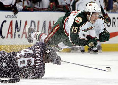 March 24: Edmonton Oilers Zack Stortini trips up Minnesota Wild James Sheppard during second period NHL action at Rexall Place. (JASON FRANSON/Sun Media)