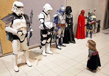 April 20: Astarte Magara, 5, takes an interest in a line of people dressed up as Star Wars characters during the Edmonton Collectible Toy and Comic Show at the Shaw Conference Centre.   (JASON FRANSON/Sun Media)