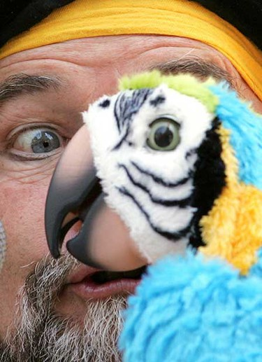 July 2: Performance artist Cap'n Arrr performs with his robotic talking parrot during the kick off to the 2008 Edmonton Street Performers Festival outside city hall.  (DAVID BLOOM/Sun Media)