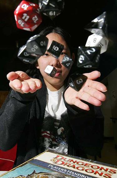 Oct. 18: Kim Yulo tosses several multi-sided dice into the air as she warms up for a game of Dungeons and Dragons during the 2008 Pure Speculation sci-fi festival at Hazeldean Community Hall, 9639 - 66 Ave.   (DAVID BLOOM/Sun Media)