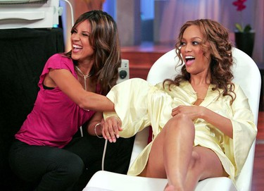 """Tyra Banks (R) gets a sonogram of her breasts administered during a taping of """"The Tyra Banks Show"""" in Los Angeles Sept. 20, 2005. Banks decided to end rumours that her breasts are fake by having an on-air sonogram in front of the studio audience to prove that they are not implants. Banks uses a push-up bra when she models. (File photo)"""