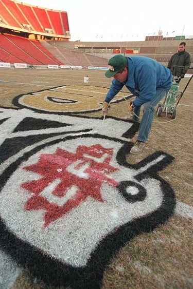 The finishing touches are put on the Grey Cup logo at centre field at Commonwealth Stadium before the 1997 game. (PERRY MAH/Sun file) ()
