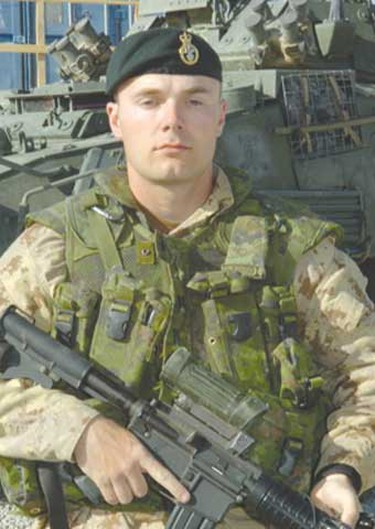 """Cpl. Bryce Keller, Aug. 3, 2006: Killed alongside his two comrades, the 27-year-old Keller's funeral touched across the lines of family and country when his wife Sarah - a member of the Edmonton-based 1 Field Ambulance """" wore her dress uniform and stood at attention by his grave. Along with his family, he left behind his beloved dog, Finn MacCool. (Hand-out)"""
