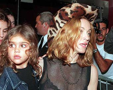 Madonna holds her daughter, Lourdes, as they leave the Versus by Versace Spring 2000 fashion show, September 12, 1999, at New York's Roseland Ballroom. ((AP Photo/Mitch Jacobson))