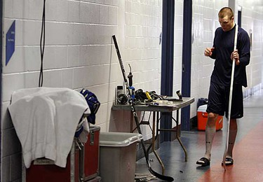 Goalie Justin Pogge gets his stick ready for the game after a Marlies' game day skate at the Blue Cross War Memorial Arena in Rochester, N.Y., in March 14, 2009. (DAVE ABEL/SUN MEDIA)