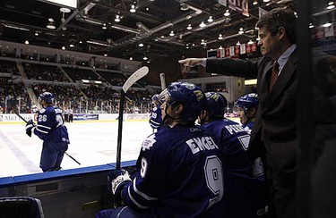 Assistant coach Jim Hughes gives direction from the bench during action between the Toronto Marlies and the Rochester Americans at the Blue Cross War Memorial Arena on March 13, 2009. (DAVE ABEL/SUN MEDIA)