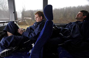 Coaches Greg Gilbert (left) and Jim Hughes relax during the bus ride from Toronto to the Oncenter War Memorial Arena to play the Crunch in Syracuse, N.Y., on March 10, 2009. (DAVE ABEL/SUN MEDIA)