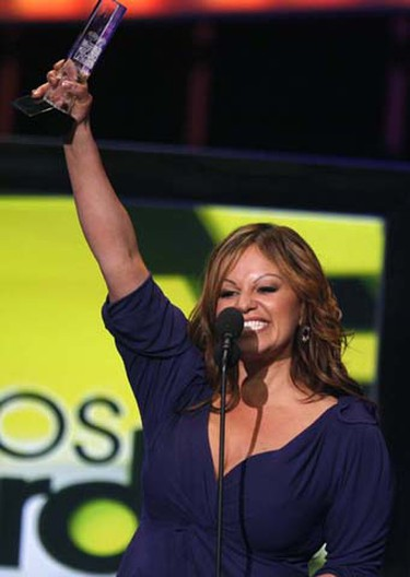 Mexican singer Jenni Rivera receives her award for top album by a woman performer at the 2009 Billboard Latin Music Awards in Miami, April 23, 2009. (Carlos Barria/REUTERS)