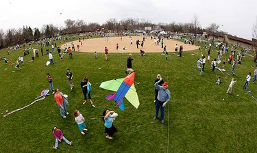 A man launches his kite as he takes part alongside 1,182 participants in an attempt to set the world record for the most number of kites aloft at the same time in one location in Wheaton, Illinois on April 18, 2009.  (REUTERS)