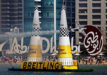 Austrian pilot Hannes Arch of Team Abu Dhabi competes during the final of the first stage of the Red Bull Air Race World Championship in Abu Dhabi on April 18, 2009. Arch won the race. (REUTERS)