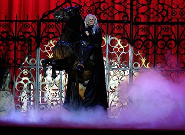 """A member of the """"Circo de la Horrores"""" (Horror Circus) company dressed as Death performs on a horse during a rehearsal of their last show """"Psicosis"""" in Madrid on April 17, 2009. (REUTERS)"""