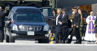 Family members approach the hearse carrying Trooper Karine Blais at Canadian Forces Base Trenton on April 16, 2009. Trooper Blais was killed when her vehicle struck an improvised explosive device north of Kandahar City in Afghanistan on April 13, 2009.  (REUTERS)
