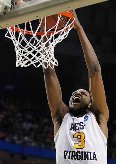 West Virginia's Devin Ebanks goes up for a slam dunk against Morgan State during the first half of their NCAA Division I men's basketball tournament game in Buffalo, New York on March 19, 2010. (REUTERS)