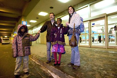Wendy and Tom Neudorf arrive at the Edmonton International Airport Jan. 25 with their two adopted children, Samanta, 10 and her brother Junior, 9, both from Haiti.  (AMBER BRACKEN/EDMONTON SUN)