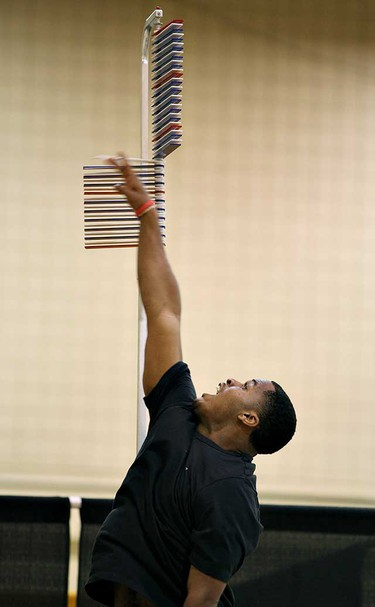 Miami of Ohio product defensive back Darrell Hunter does the vertical leap test. (KEN ARMSTRONG/Sun Media)