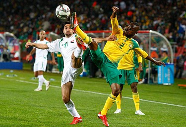 Iraq's Hawar Mulaa Mohammed fights for the ball with South Africa's Siboniso Gaxa during their Confederations Cup 2009 soccer tournament at Ellis Park stadium in Johannesburg on June 14, 2009. (REUTERS)