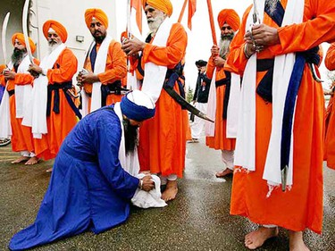 May 17: A Sikh man practises selfless service by washing the feet of the holy men at the end of the 11th Annual Vaisakhi Nagar Kirtan that wound up at the GGurdwara Siri Guru Singh Sabha, 2606 Millwoods Rd. E. Vaisakhi, officially celebrated on April 14, is both a celebration of the new harvest season and the anniversary of the beginning of the Sikh religion. A Nagar Kirtan is essentially a holy parade. (AMBER BRACKEN/Sun Media)