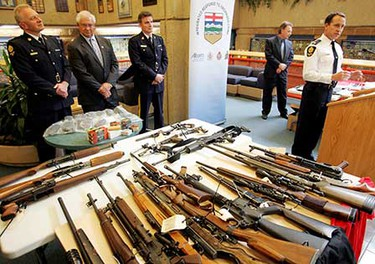 Jan. 29: Weapons are displayed that were seized in a year-long investigation involving the province's IROC (Integrated Response to Organized Crime) team, the city police gang unit and the RCMP. Cops charged a dozen White Boy Posse members with nearly 100 crimes. Seized were 28 firearms, about $500,000 in cocaine, over $300,000 in cash, 3,000 ecstasy pills and various stolen goods. (JASON FRANSON/Sun Media)