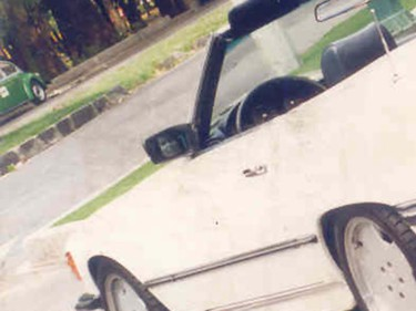 """The photographer says nobody was around when he snapped this picture of his car and so can't explain the face in the left side-view mirror. Some argue the """"face"""" could be of someone standing nearby or a reflection of the seat's headrest. The photo could also have been altered on a computer. (Photo by Guillermo Sosa, courtesy of www.richardwiseman.com)"""