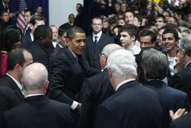 U.S. President Barack Obama greets participants during a Town Hall meeting in Strasbourg April 3, 2009. The North Atlantic Treaty Organization (NATO) military alliance is celebrating its 60th anniversary this week at a summit co-hosted by Germany and France. (Jason Reed/REUTERS)