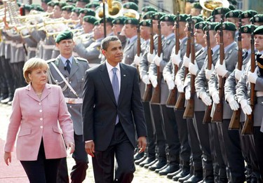 U.S. President Barack Obama and German Chancellor Angela Merkel inspect the guard of honour during a welcoming ceremony in Baden-Baden, April 3, 2009. Obama called for a world without nuclear weapons on Friday after arriving in France for a NATO summit, where he won French endorsement of his new Afghanistan strategy. (Yves Herman/REUTERS)