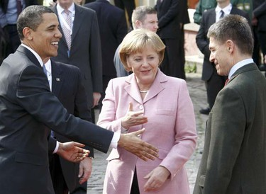 German Chancellor Angela Merkel introduces her husband Joachim Sauer (right) to U.S. President Barack Obama in Baden-Baden, April 3, 2009. Obama called for a world without nuclear weapons on Friday after arriving in France for a NATO summit, where he won French endorsement of his new Afghanistan strategy. (Fabrizio Bensch/REUTERS)