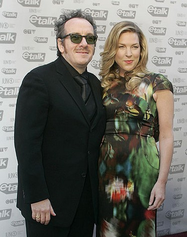 Jazz singer Diana Krall and her husband Elvis Costello arrive on the red carpet during the Juno Awards in Vancouver, British Columbia March 29, 2009.         REUTERS/Richard Lam