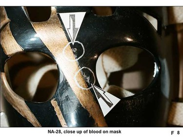 A  black and gold goalie hockey mask with blood on it was seized from Twitchell's St. Albert home. (Court evidence)