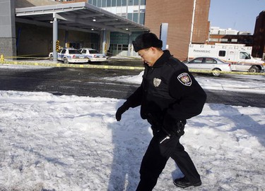 Images from the scene of this morning's murder of an Ottawa Police officer outside the emergency room doors at the Ottawa Hospital Civic Campus Dec 29, 2009 in Ottawa.  (ANDRE FORGET/Ottawa Sun)