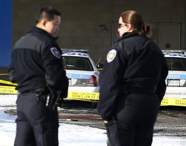 Two police officers talk at the scene of this morning's murder of an Ottawa Police officer outside the emergency room doors at the Ottawa Hospital Civic Campus Dec 29, 2009 in Ottawa. A knife and pistol are seen. (ANDRE FORGET/Ottawa Sun)