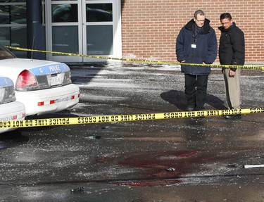 Investigators at the scene of this morning's murder of an Ottawa Police officer outside the emergency room doors at the Ottawa Hospital Civic Campus Dec 29, 2009 in Ottawa. A knife and pistol are seen. (ANDRE FORGET/Ottawa Sun)