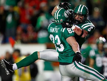 Saskatchewan Roughriders slot back Andy Fantuz (L) celebrates his touchdown against the Montreal Alouettes with teammate Rob Bagg during the first half of the 97th CFL Grey Cup football game in Calgary, on Nov. 29, 2009. (REUTERS)