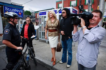 Shannon Tweed and Gene Simmons toured Ottawa's sites Tuesday. The couple stopped to chat with by-law officers. (ERROL MCGIHON/Sun Media)